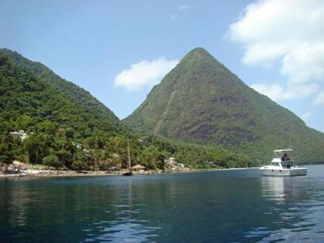 At the marine reserve in St. Lucia's Soufriere Bay, you can snorkel in clear water between the twin peaks of the Pitons.