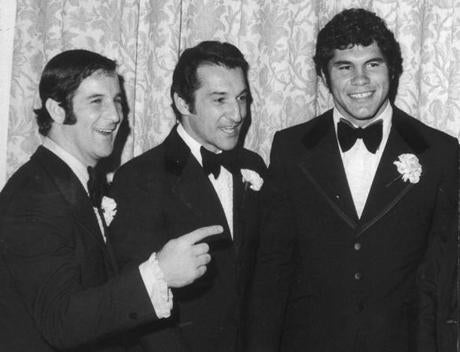 December 11, 1971: Joe Bellino (left) and Jim Plunkett (right), two former Heisman trophy winners, talked with newly-retired Patriots wide receiver and placekicker, Gino Cappelletti, at a testimonial dinner in his honor at the Sheraton Plaza in Boston. The head table included New Yorkers, Joe Namath, Sonny Werblin and Andy Robustelli.