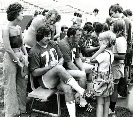 fromthearchive August 11 1973 / fromthearchive / Globe staff photo by Frank O'Brien / Patriot's defensive tackles Dennis Wirgowski and Dave Rowe sign autographs at a Patriots pre-season practice.