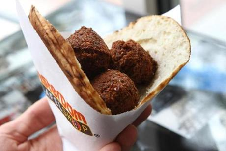 Start out with a sandwich or bowl of falafel balls and add the toppings at Amsterdam Falafel Shop in Davis Square