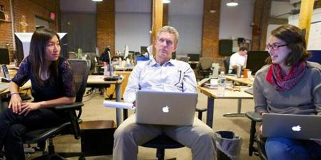 Bill Powers, who oversees Bluefin's blog, The Crowdwire, watches a presidential debate with colleagues.
