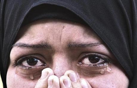 A Palestinian woman cried during her brother's funeral Friday. Audi Naser, 10, was killed in an Israeli air strike.