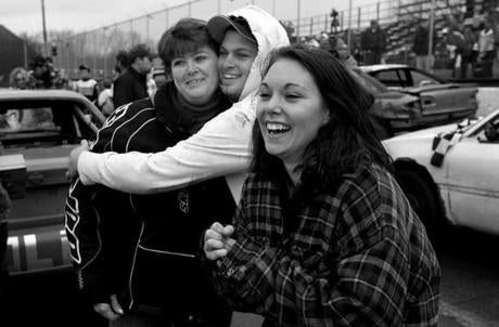 Groveton, N.H. 11-3-12 - Wendy Bennett (cq), at left, of Stark, N.H. and family members watch as her husband Floyd Bennett Jr. (cq) accepts the trophy after winning the 200 lap Enduro race at Riverside Speedway. After a late collision in the final laps with Nick Gilcris (cq), Bennett held on for the win. (Globe staff photo / Bill Greene)