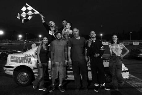 Paul Ouellette and his racing family from Milan, N.H., posed for a photo after his 15-year-old daughter Nicole (with checkered flag) won the Angels division. Aug. 25, 2012.
