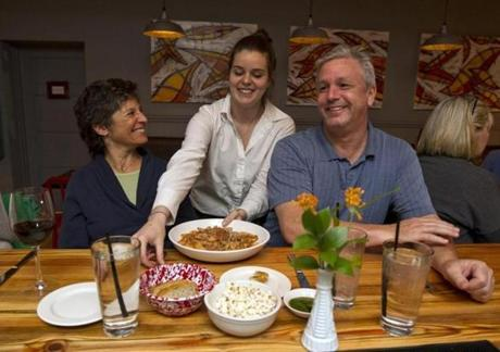 Shannon Towmey a waitress at the Waban Kitchen served a plate of bolognese to Nancy Horwitz of Newton and John Devereaux of Stoneham.