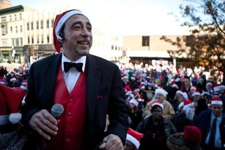 John Merian, a Brockton businessman, organized the Santa Hat Challenge and emceed the event.