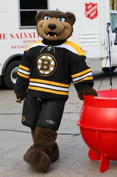 BOSTON , MA.11/ 19 / 2012: Even the Boston Bruins mascot...BLADES...showed up to give a ring....forThe Salvation Army of Massachusetts kicks off 2012 Red Kettle campaign by Brewer Fountain on Boston Common near MBTA Park St. station. ( David L Ryan/Globe Staff Photo ) SECTION: METRO TOPIC 20kettles(1)