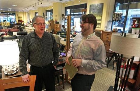 Richard Tubman (left), the owner of Circle Furniture, talked with Troy Scheuer, an employee. Tubman said sales have increased 10 percent over a year ago. Shoppers are now refurnishing rooms, not buying single pieces.