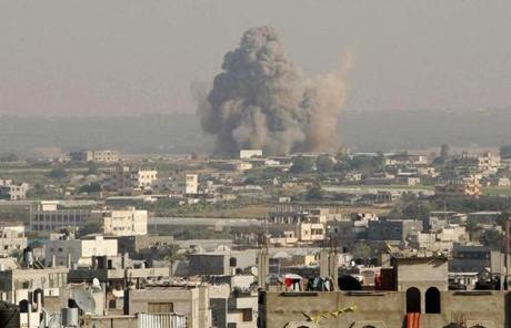 Smoke rose from what witnesses said was an Israeli airstrike in Rafah, in southern Gaza.