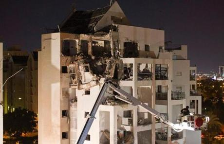 Rescue workers were at the scene of a building near Tel Aviv damaged by a rocket.
