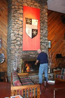 Scott James tends to the fireplace at the Massa-Schussers Ski Club.
