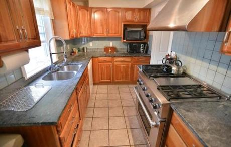 Stainless appliances, granite counters and tile are featured in the kitchen.