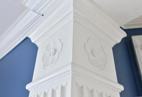 Period woodwork details line the walls.