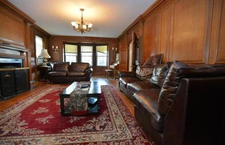 A wood-paneled parlor with a bay window is located just off the foyer.