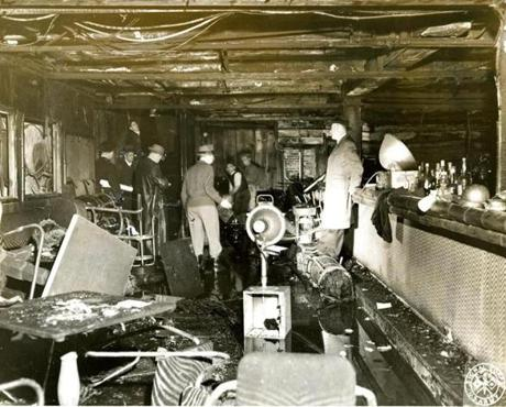 November 30 1942 / Investigators sifted through the ruins after the fire. One of the largest night clubs in Boston, the Cocoanut Grove had three rooms, the night club on the street floor; the Melody Lounge in the basement and the Cocoanut Grove Lounge and cocktail bar which was a new addition which had opened just the previous week with an entrance on Broadway. The main entrance to the Grove was on Piedmont Street. Although the license was for 460 persons, it is estimated that over 1000 persons were there the night of the fire.