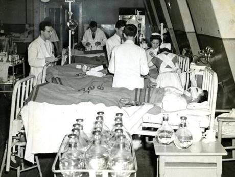 November 28 1942 / Staff at the emergency ward at Boston City Hospital attended to those patients who could be treated for their burns from the fire. The dead were brought in and piled sheet-clad in the corridors. Hospital Superintendent Dr. James Manary said,