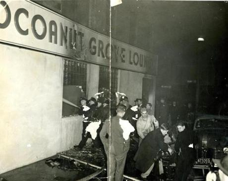 November 29 1942 / Firemen stream water into the Cocoanut Grove Lounge through the windows. Although the windows were wide and not more that four feet above the sidewalk level, they were made of