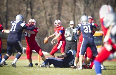 Natick quarterback Troy Flutie prepared to pass the ball during the game against Framingham.