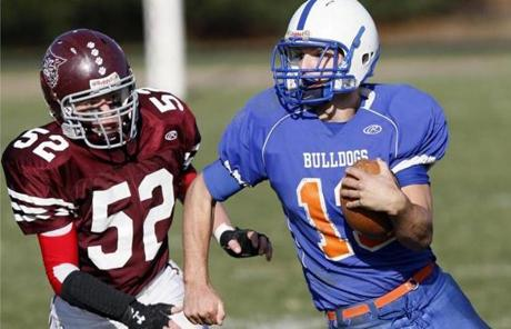 Holbrook High's Ben Riordan broke past West Bridgewater's Cameron O'Reilly. West Bridgewater won, 27-20.