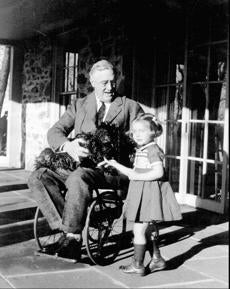 President Roosevelt in 1941 with the granddaughter of the caretakers of his cottage retreat near his Hyde Park home.