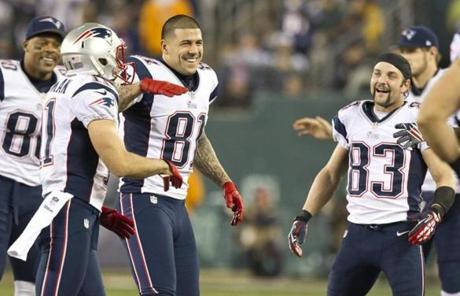 Edelman was greeted by (left to right) Shainco Viosanthe, Aaron Hernandez, and Wes Welker after a touchdown.