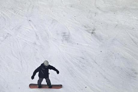A lone snowboarder made his or her way down Exodus run.