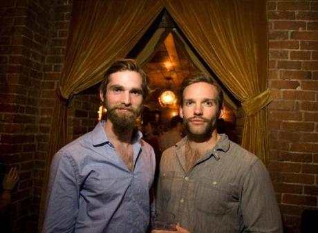From left: Brothers Brett and Alec Phillips, both of Boston, showed off their Movember mustaches at Brahmin in Boston on Friday, November 24, 2012.