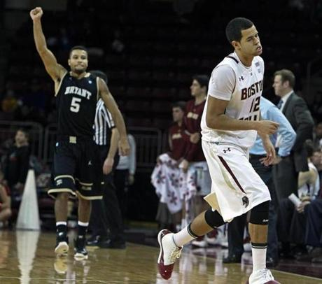 Bryant's Frankie Dobbs (left) and BC's Ryan Anderson had different reactions after Anderson's last-second shot would not fall, giving Bryant a 56-54 victory over the Eagles.