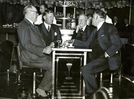 December 6, 1933:  Arthur L. Race (left), manager of the Copley Plaza and one of the leaders in the repeal battle among hotel men, had the honor of serving the first drinks in Massachusetts at the Copley Plaza's Merry-Go-Round bar to (from left) Declan Corcoran, an attorney in Senator Walsh's office; Governor Joseph B. Ely and Senator David I. Walsh. The word had just flashed that Utah had ratified the 21st Amendment and repeal was a reality when Gov. Ely and Senator Walsh arrived at the hotel.