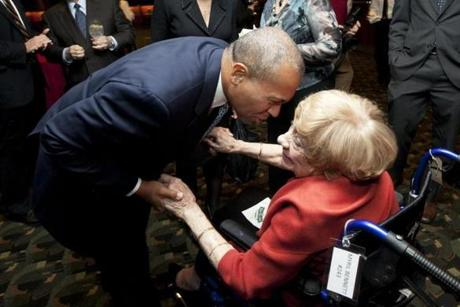 Boston, MA - 11/28/2012 - Massachusetts governor Deval Patrick (cq) greets Myril Bennett Axelrod (cq), mother of political consultant David Axelrod. The CURE Benefit for epilepsy takes place at Fenway Park in Boston, MA on Wednesday, November 28, 2012. (Yoon S. Byun/Globe Staff) Slug: 29epilepsy Reporter: goldstein LOID: 5.0.3923857819