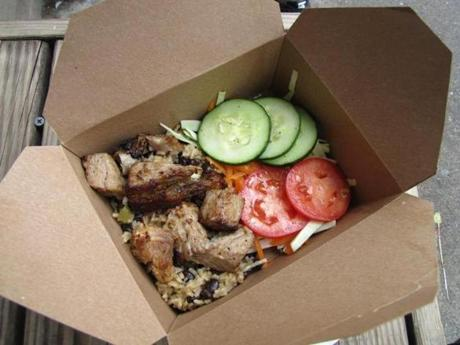 Cuban food to-go at Conflict Kitchen: black beans and rice with roast pork.