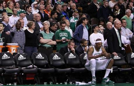 Paul Pierce sat alone on the bench as officials sorted out the penalties following the fight.