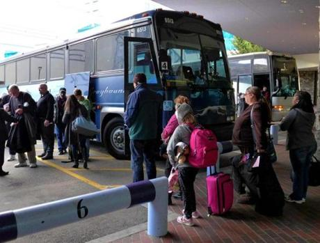 Passengers disembark from Greyhound bus at Foxwoods as others wait to get on board.