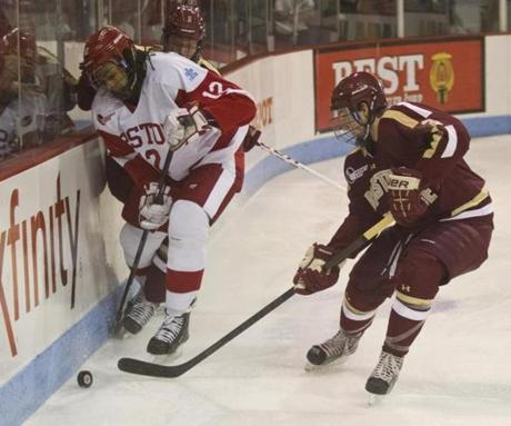 BC's Patch Alber (3) closes in on BU's Yasin Cisse, who has control of the puck.