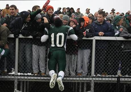 Abington's Babila Fonkem (10) celebrated his team's victory over St. Mary's in the High School Super Bowl in Milton. Dec. 1, 2012.