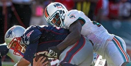 Brady was sacked by Dolphins safety Reshad Jones.