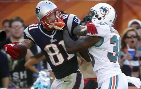 Dolphins safety Chris Clemons grabbed Hernandez by his face mask during the second half.