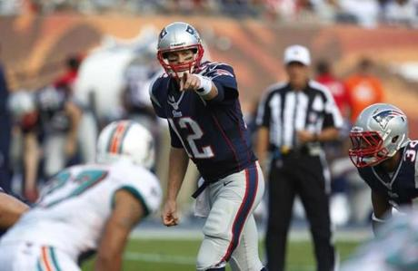 New England Patriots quarterback Tom Brady gestured from the line of scrimmage during the first half.