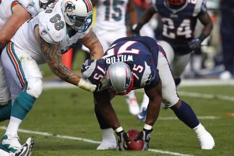 Patriots defensive tackle Vince Wilfork recovered the ball after Dolphins quarterback Ryan Tannehill was sacked and fumbled during the first half.