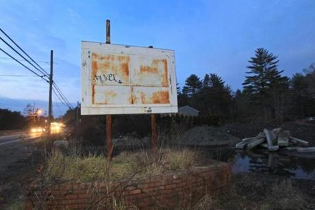 The old sign at the Alpine Motel on Wareham Street in Middleborough and rubble is all that remains after an Oct. 23 fire.