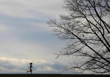 A jogger took advantage of some nice weather to go for a run long the Chestnut Hill Reservoir.