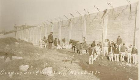 Inmates worked on the grading along the north wall of the prison in March 1934.