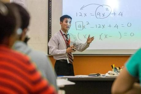 Math teacher Long Le, who is Vietnamese, helped launch a group for Asian students to provide assistance in managing academic expectations and making social connections.