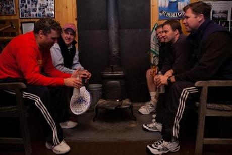 Players warmed up around a wood burning stove at the Concord Country Club.
