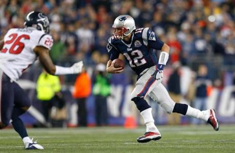 Tom Brady of the New England Patriots ran the ball for a first down against the Houston Texans in the second half.