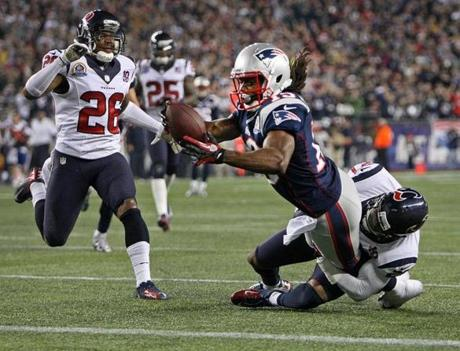 After Patriots WR Donté Stallworth beat Texans defender Brandon Harris, left, as he hauled in a pass from quarterback Tom Brady (not pictured), he caught the ball, deked out defenders and dove into the end zone for a touchdown.