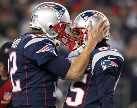 Brandon Lloyd was wide open as he hauled in a 37 yard touchdown pass from Tom Brady (left, pictured as they celebrated the score together) for the second New England score of the game.