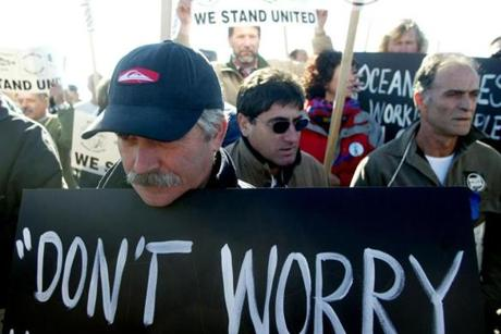 Commercial fisherman Carlos Patrao of New Bedford and hundreds of other fishermen rallied at the Gloucester Fisherman's Monument in protest of new fishing rules ordered by a judge who agreed with envronmentalists that fish stocks were being overfished.