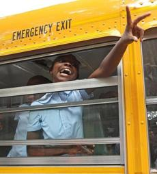 BOSTON ,MA 09 / 05/ 2012: ALL EXCITED is Niaysa Hill ( cq) a 3rd grade student who arrived by bus on the first day of school at Ellis Elementary, 302 Walnut Ave., Roxbury ( David L Ryan / Globe Staff Photo ) SECTION: METRO TOPIC07backtoschool
