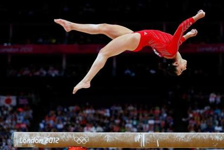 Aly Raisman, shown on the balance beam, left the SUmmer Olympics with three medals, two of them gold.